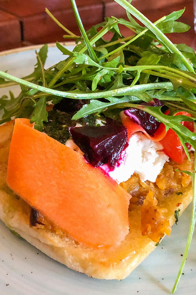 Goats cheese and beetroot salad with with rocket on bread
