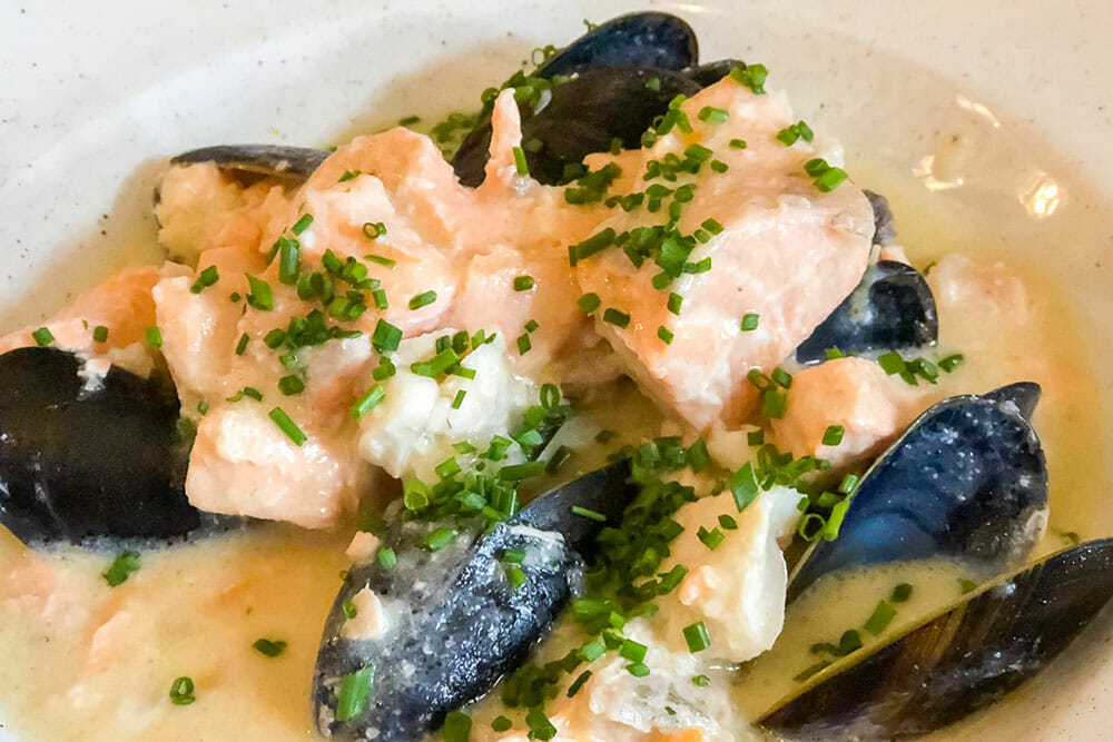 Chowder with salmon mussels and chives