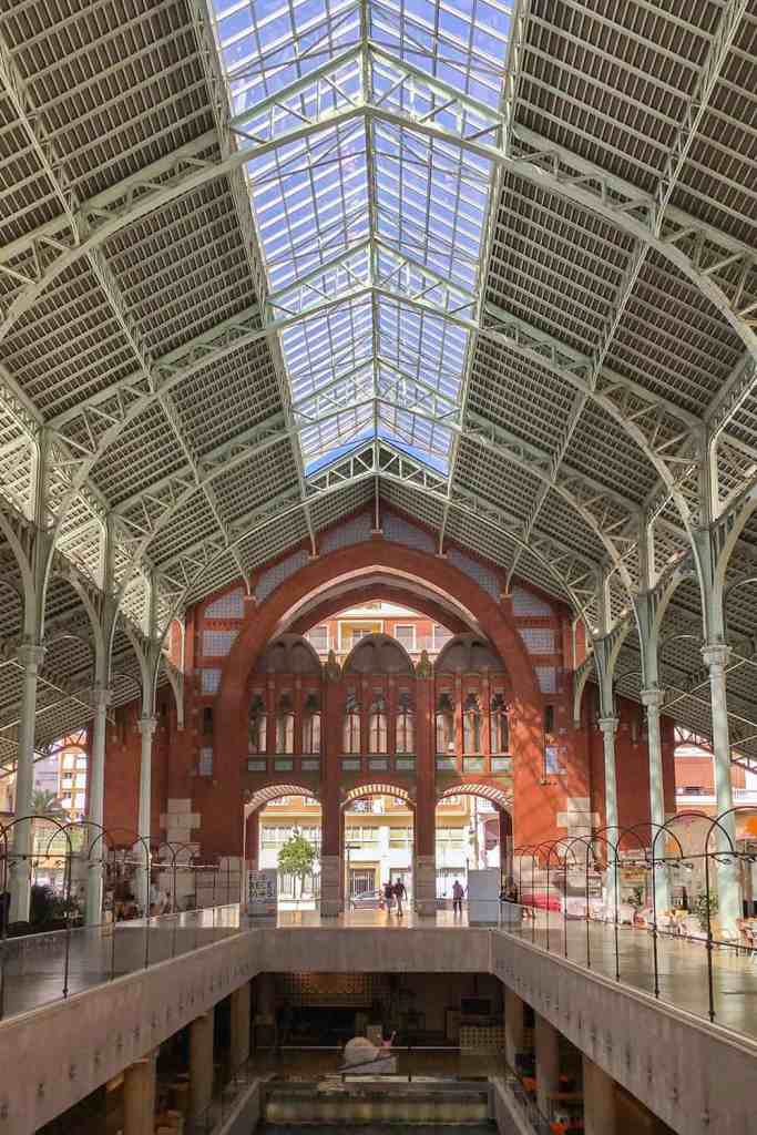 Interior of Mercado Colon with iron columns and entrance in the background