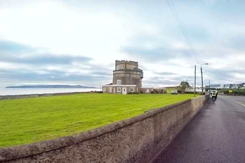 Adventure in Dublin Cycling along county Dublin Coast Ireland martello tower