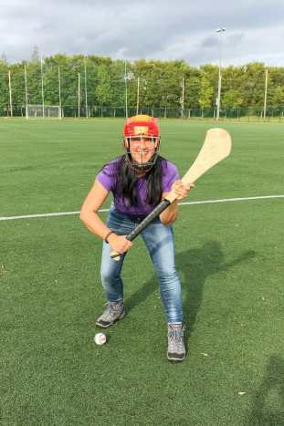 Adventure in Dublin Holding hurling stick ready to play