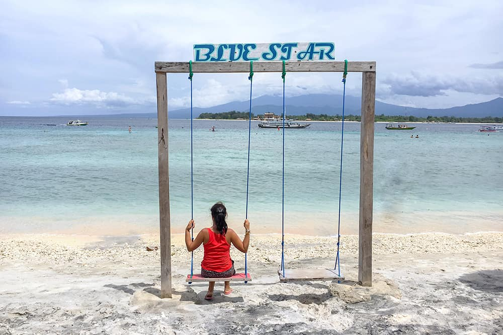 Sitting on a swing on the beach in Gili Trawangan Indonesia