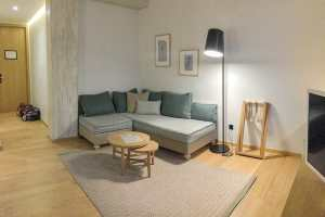 Sofa area at Boulevard Suite in Coco-Mat Athens Boutique Hotels
