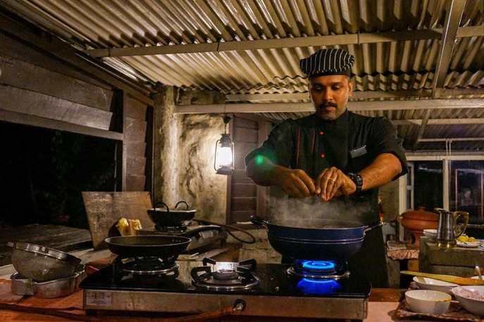 Chef giving a cooking demonstration of Kerala fish curry at Windermere Estate Munnar India - #munnar #kerala #india