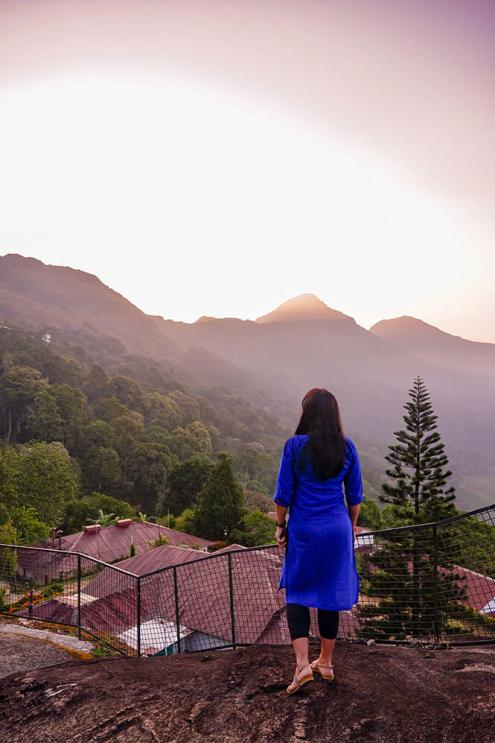 Enjoying the view of the sunrise over the mountains in Munnar, Kerala - #munnar #kerala #india