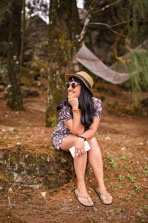 Portrait sitting on a rock on a wooded area of Windermere Estate in Munnar - #munnar #kerala #india