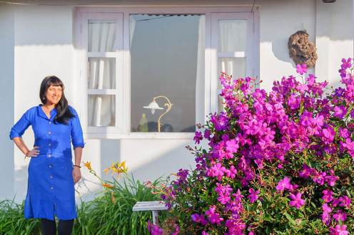 Portrait outside bungalow with flowers in Windermere Estate, Munnar - #munnar #kerala #india