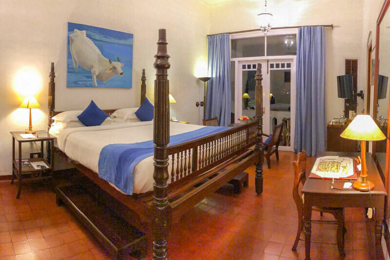 Room with four poster bed at the Brunton Boatyard Hotel - #kochi #Kerala #India