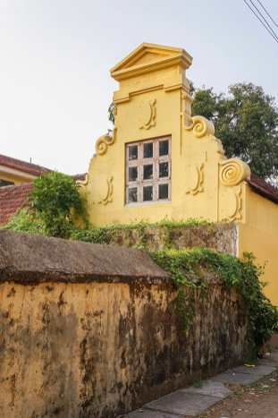 The wall of the historic Dutch Cemetery in Kochi