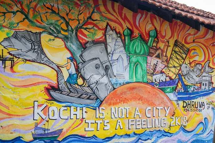 Street art mural reading Kochi is not a city, it's a feeling
