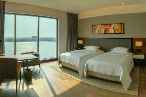 Twin room at the Grand Hyatt Kochi Bolgatty Hotel with views over the water