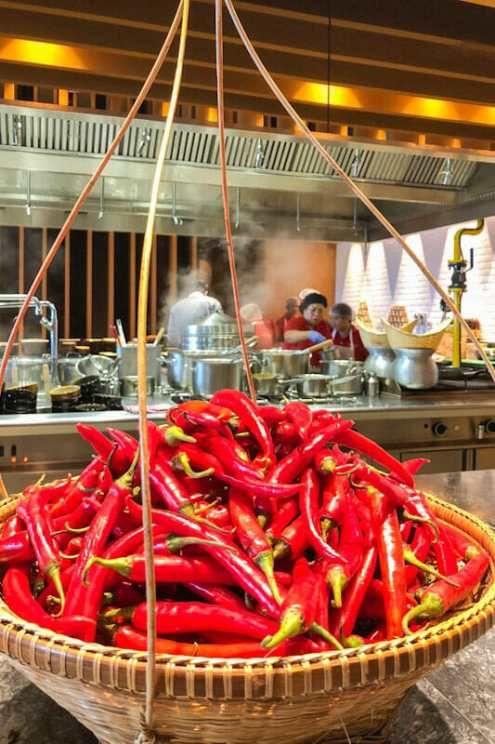 Basket with red chillies in the kitchen of the Thai Soul Restaurant at the Grand Hyatt Kochi Bolgatty Hotel