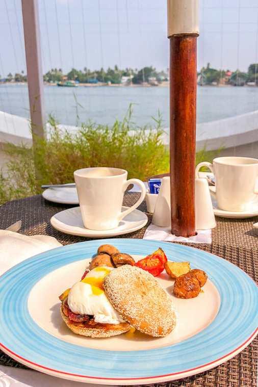 Breakfast of egg benedict overlooking the sea
