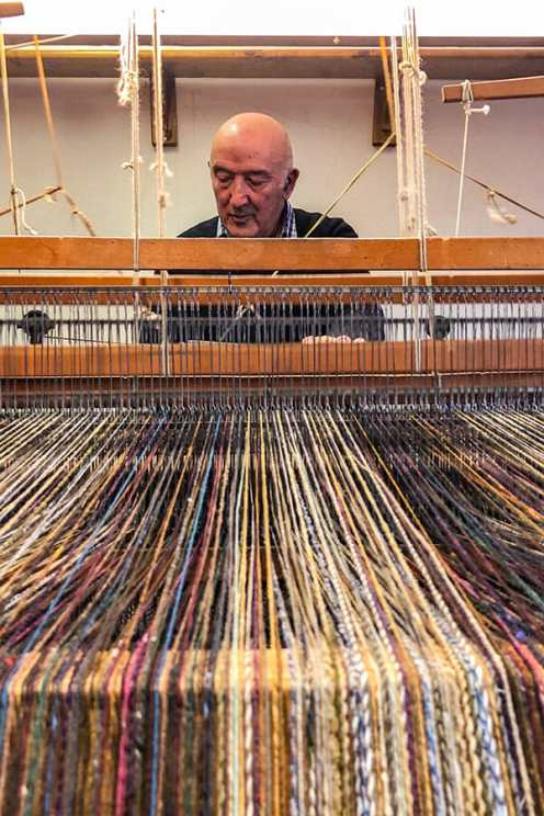 Eddie Doherty operating his weaving machine seen from the front