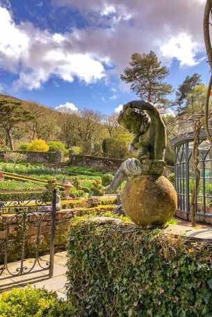 Stone cherub overlooking the formal garden at Glenveagh Castle