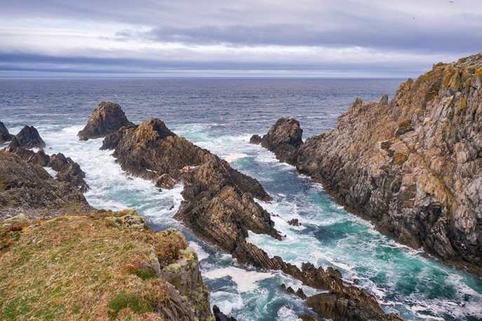 View of the rocky coast and wild sea at Malin Head, Donegal
