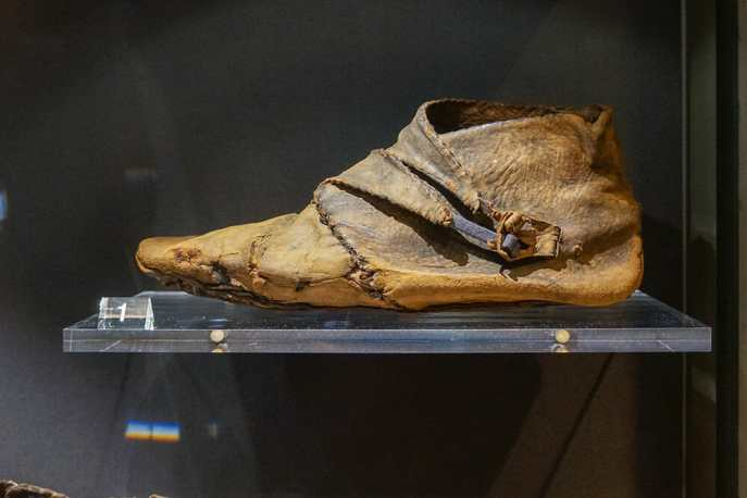 Old Viking shoe on a display glass shelf