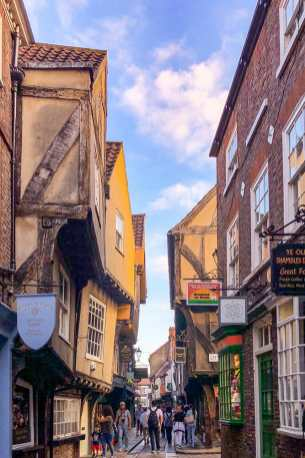 Overhanging Medieval timber framed buildings in a narrow street