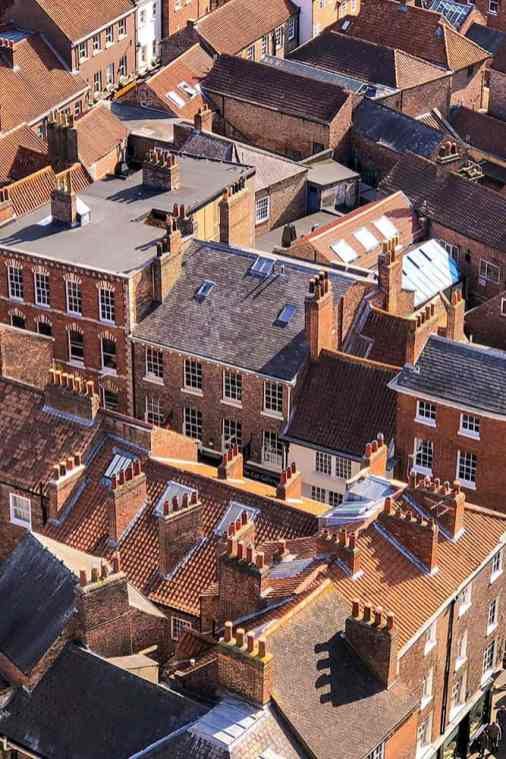 View of terracotta and slate rooftops of York from the top of York Minster