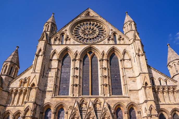Side view of York Minster with stained glass windows and rose