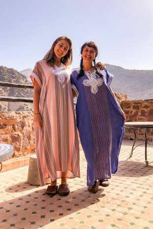 Two of us wearing long traditional Berber dresses