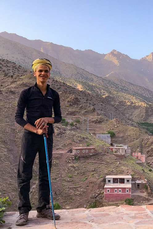 Berber man standing with the view of the village behind him