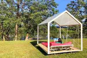 Relaxing on a day bed while glamping in Slovenia, at the the Big Berry luxury lifestyle resort