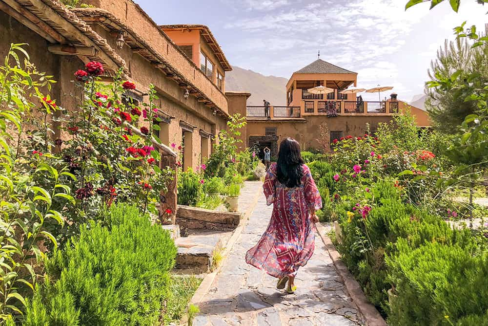 Walking up the garden towards the Kasbah with flower beds on both sides