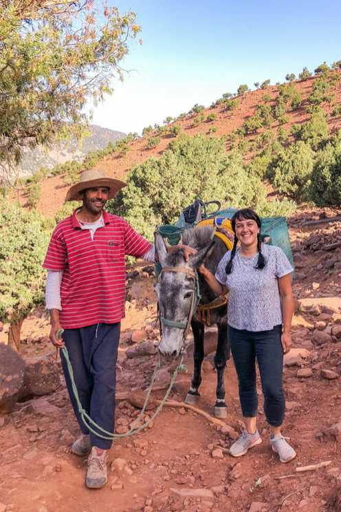 Photo with Mohamed wearing a straw hat and the mule standing between us