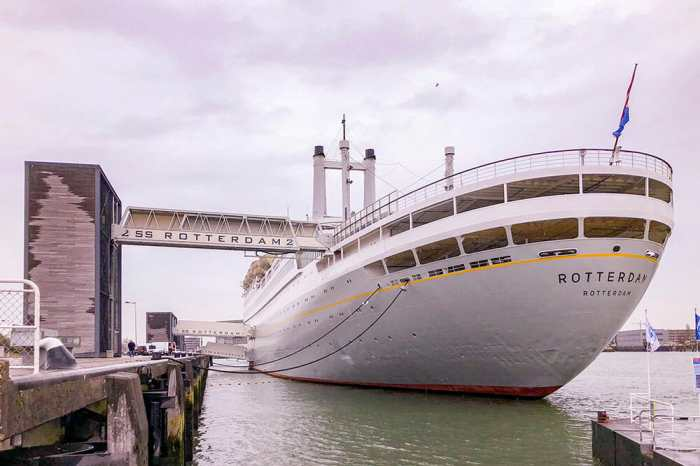 Big ship SS Rotterdam seen from the back with bridge to land