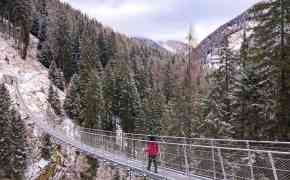 Visiting the Rigaiolo suspension bridge is one of the things to do in Trentino in winter