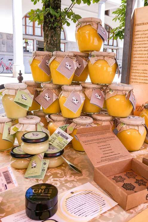 Jars of butter ghee stacked up on a stall