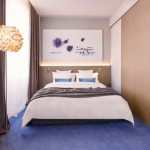 Hotel room with double bed and blue carpet