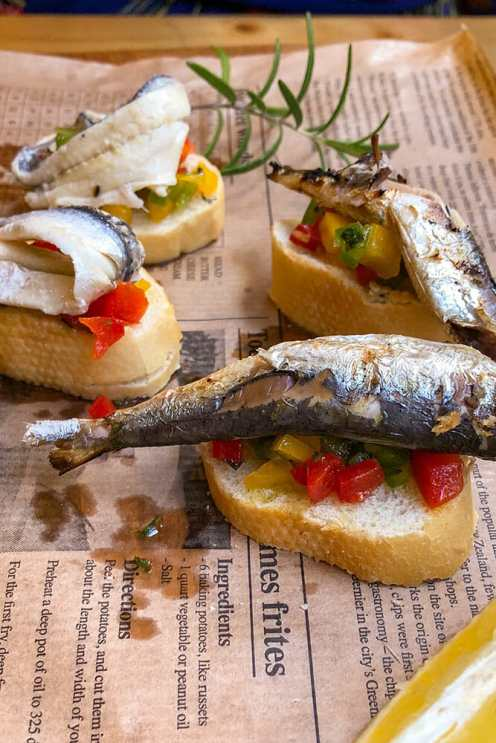 Grilled sardines on a slice of bread