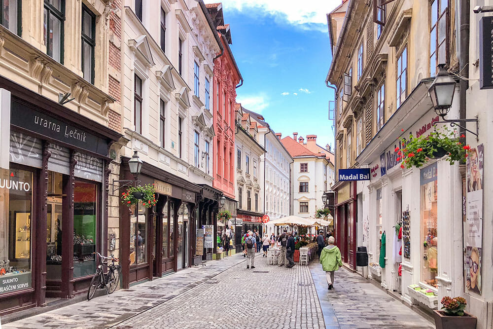 Cobbled street with pastel coloured buildings in Ljubljana Old Town