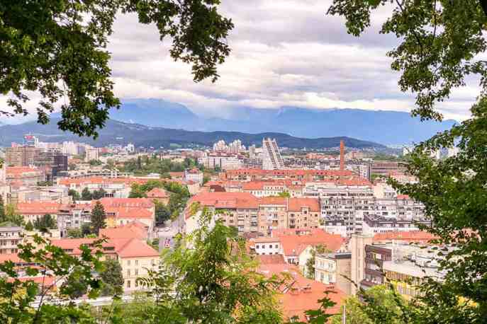 View of Ljubljana city from the castle framed by tree branches