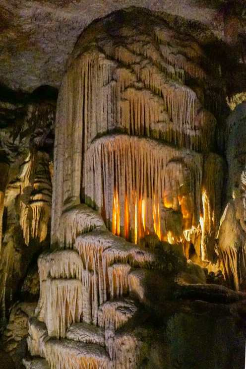 Stalactites forming a waterfall effect in Postojna Cave, one of the best places to visit in Slovenia