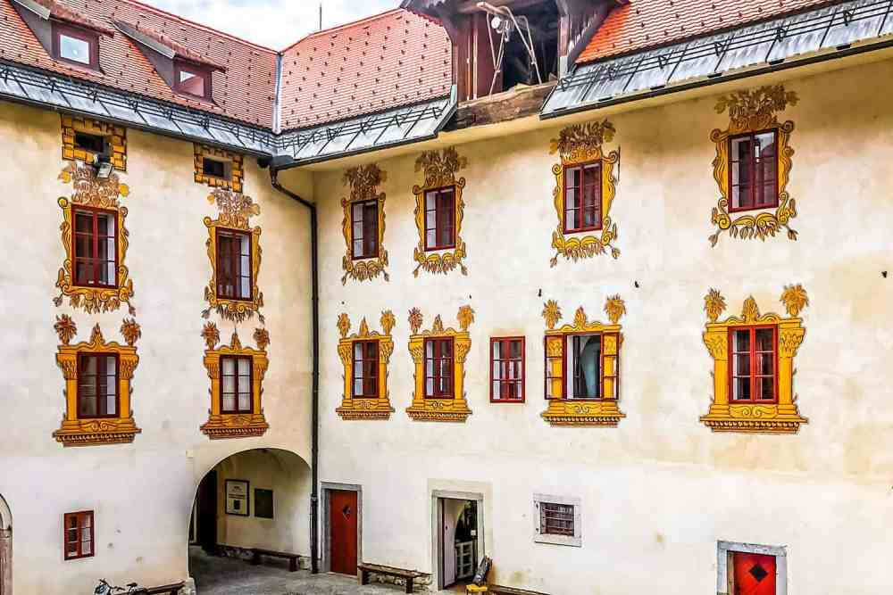 Facade of a fortress or castle with highly decorated windows