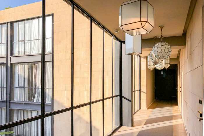 Corridor with one glass wall and lanterns