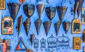 Shopping in Morocco for souvenirs - lanterns on a blue wall
