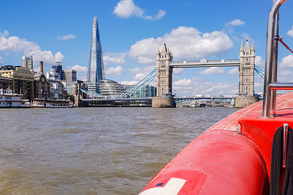 View of Tower Bridge and the Shard from a RIB speedboat on the river Thames