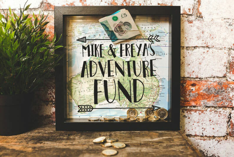 Personalised hollow framed with Adventure fund and map in the background and a slot to put money inside. The perfect Valentine's Gift for Travel Lovers