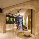 Hotel reception seen through an old stone arch