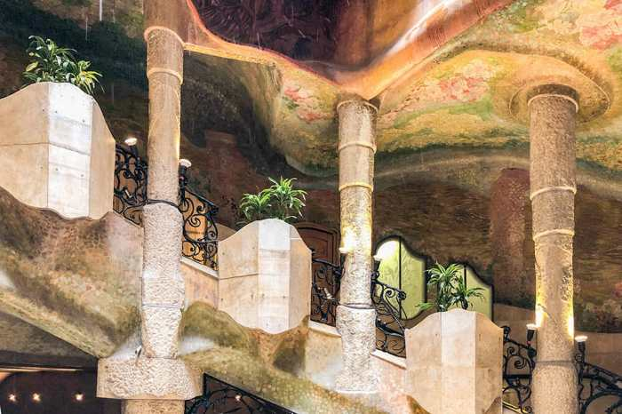 Staircase with three columns and planters with plants in between