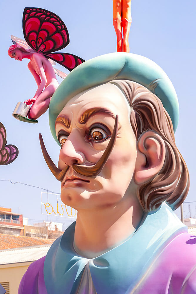 A falla sculpture depicting Salvador Dali with a fairy on his head