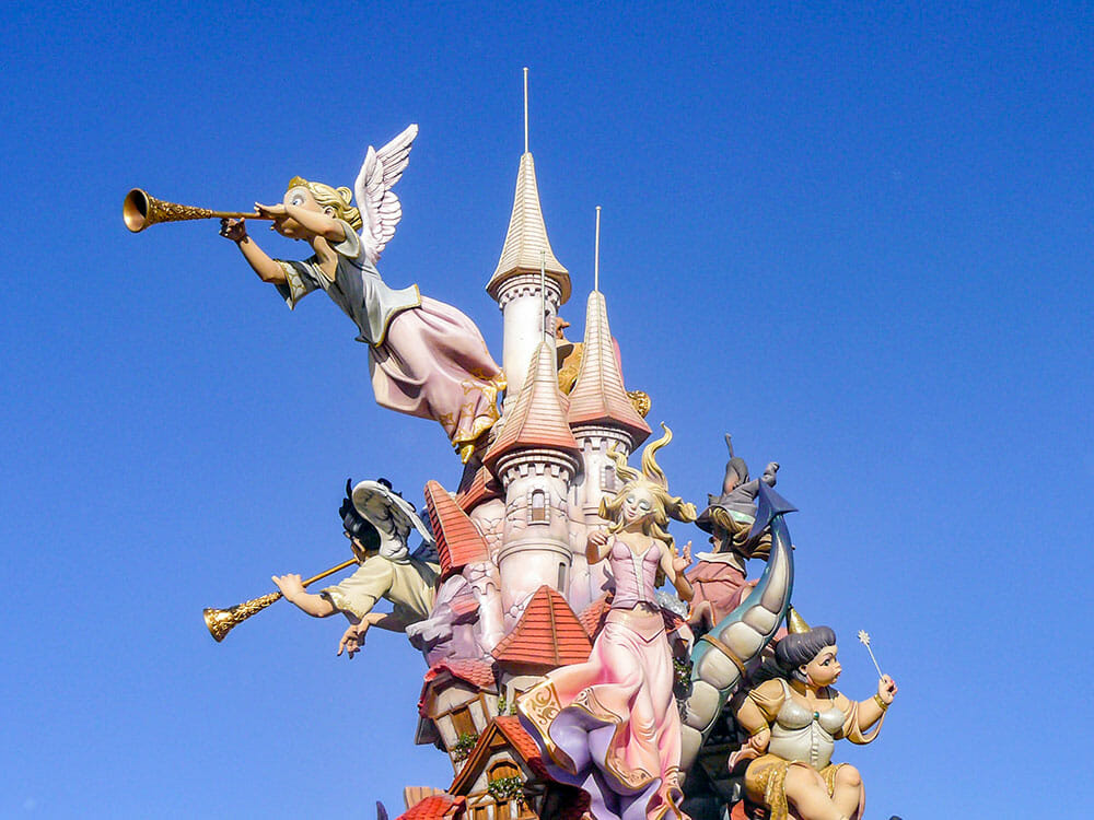 A falla sculpture depicting a Disney-like castle with two angels, a princes, a dragon and fairy godmother around it