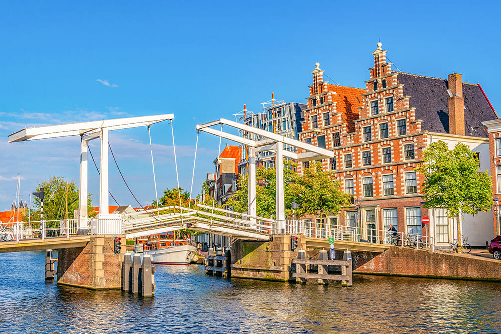 Raising bridge with Dutch houses at one end. Haarlem is one of the most beautiful cities in Netherlands