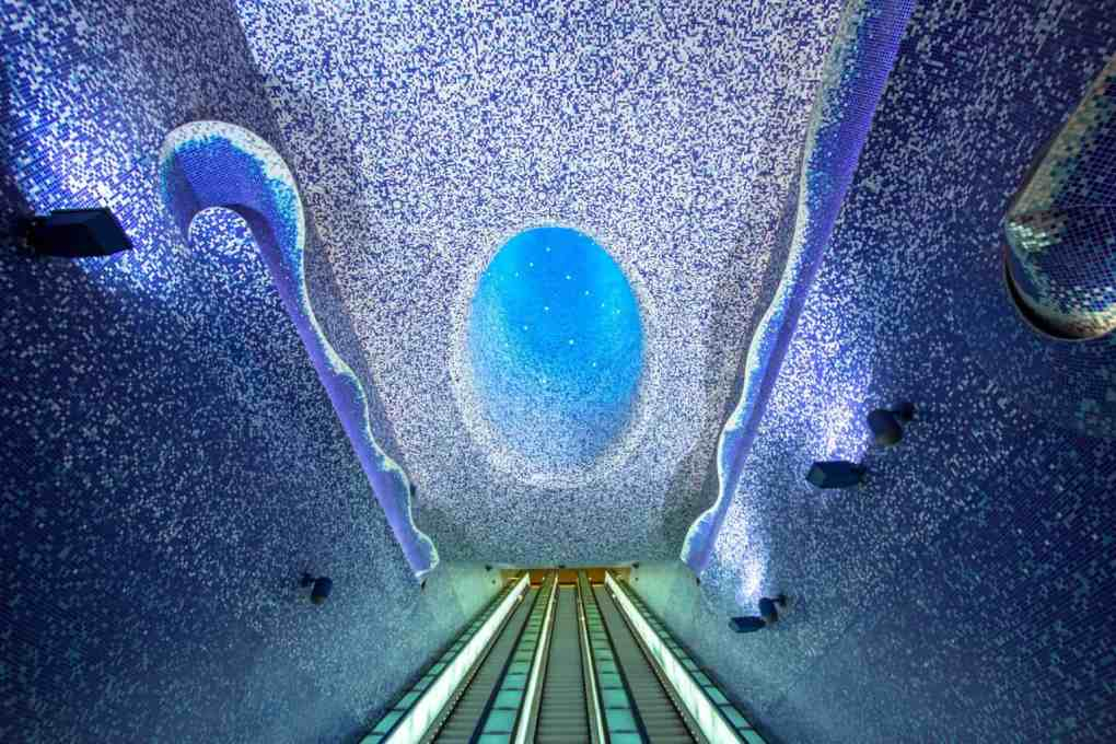 Escalators in metro station decorated like a starry sky