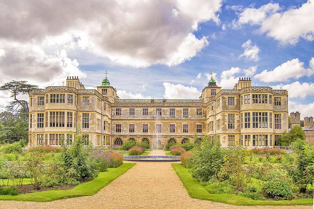 Stately home with formal gardens and a fountain