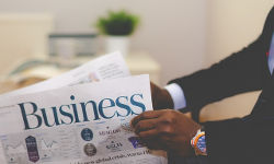 man reading business paper